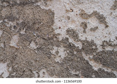 old grungy wall with peeling plaster, for backgrounds
