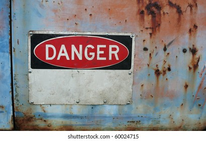 Old grungy warning sign showing danger with room for you text with rust and peeling paint.