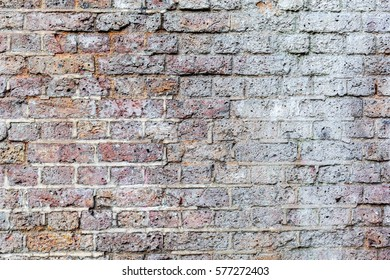 Old Grungy White and Pink Brick Wall Outside in London, England