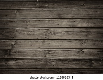Old grungy wood background texture, corners darkened