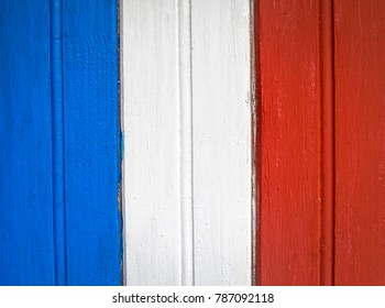 Old grungy wooden plank background painted as flag of France