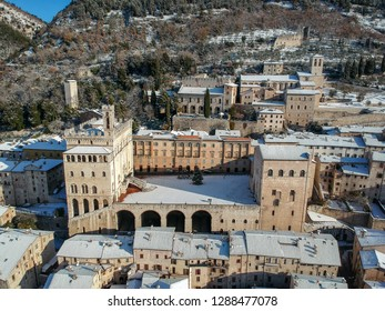 Old Gubbio in Italy covered by snow - Aerial view