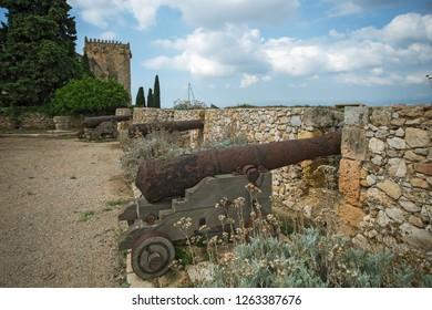 Old guns in Tarragona Passeig arqueologic (Archaeological Promenade) under Roman era walls