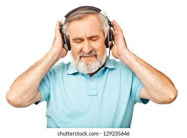 Old guy listening to music with headphones on white background