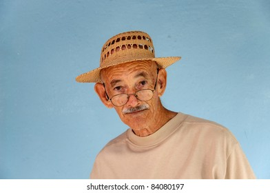 An old guy in the tropics with a hat