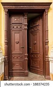 Old  half-opened wooden door in church