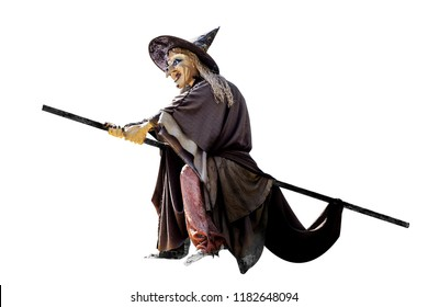 Old Halloween witch with broomstick and hat a over white background