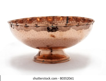 Old hammered copper bowl isolated on white background
