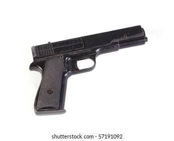 Old hand gun on a plain white background.