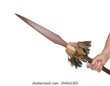 Old hand hodling an old wooden spear, isolated on white
