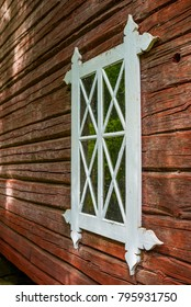Old hand made window and red ochre painted timber wall