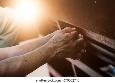 Old hand  praying in the church, Hands folded in prayer concept for faith, spirituality and religion