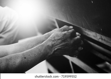 Old hand  praying in the church, Hands folded in prayer concept for faith in black and white tone, spirituality and religion