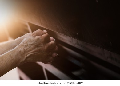 Old hand  praying in the church, Hands folded in prayer concept for faith with copy space, spirituality and religion