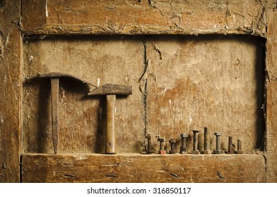 old  hand tools on a antique wooden panel  background still life