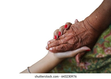 The old hand and young hand are holding. Concept of helping hands, care for the elderly.