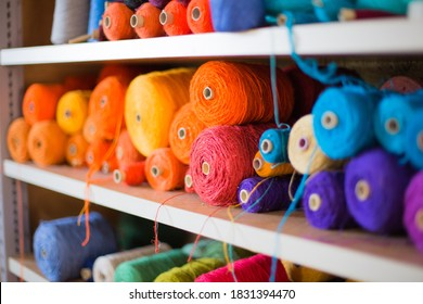 Old handcraft weaving: Different colorful thread spools for the weaving loom