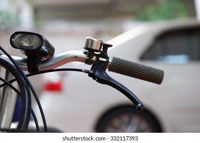 old handle of bicycle and bell
