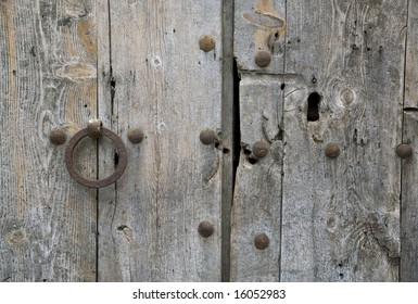 Old handle and old lock in a wood door