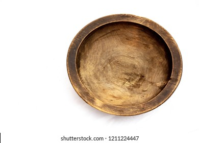Old handmade empty  wooden bowl, isolated on a white background, top view