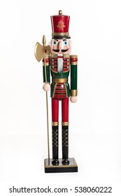 Old handmade nutcracker on an isolated studio background