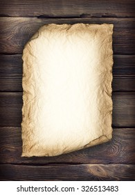 Old handmade paper sheet on wooden background