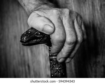 old hands with a cane