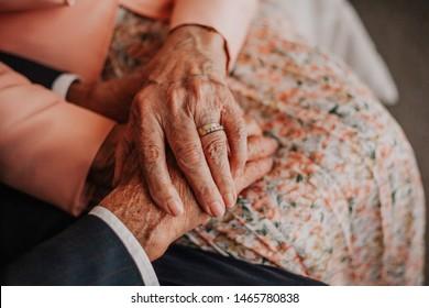 Old hands cherishing eternal love