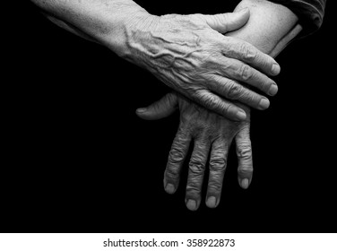 The old hands grandmother in a black background