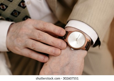 old hands with watch