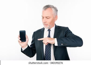Old handsome man in business suit pointing to the phone