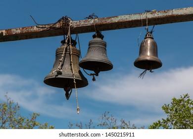 Old hanging metallic bells with ornament near ancient Jvari monastery, Mtskheta, Georgia. UNESCO world heritage site.