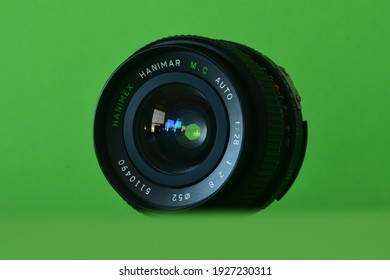 An old Hanimex lens in front of a green screen, Germany, Munich, 2021-03-01