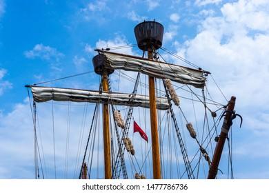 Old hanse cog masts with masthead in lübecker harbor