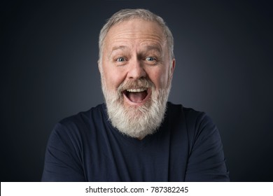 Old happy man with beard on blue background