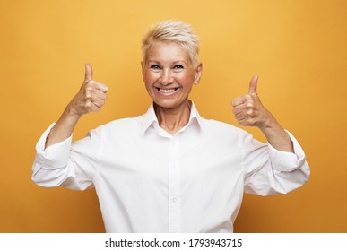 Old happy woman showing ok sign