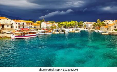 Old harbor at Adriatic sea. Hvar island, Croatia, popular touristic destination
