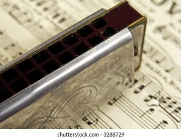 old harmonica on sheet music