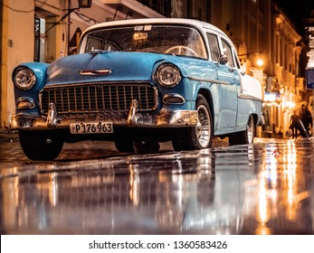 Old Havana, Cuba - June 27, 2018: Vintage Chevrolet Bel Air parked in the Calle San Ignacio. Everything returns to normal after a heavy rain.