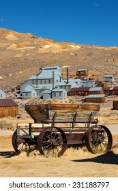 Old hay wagon in front of abandoned gold mine - Bodie State Historic Park, California