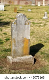 old head stone in a grave yard