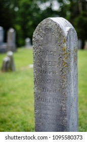 old headstone in a historic cemetery - portrait