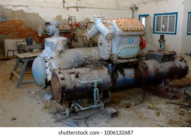 Old heat exchange equipment. Premises of a destroyed and plundered milk production plant. The raiders captured the plant. Vandalism. Ukraine, January 2018.