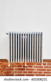 Old heating radiator on a wall, space for text.