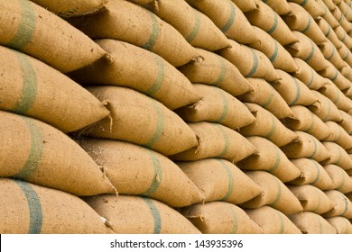 Old hemp sacks containing rice placed profoundly stacked in a row to keep up.