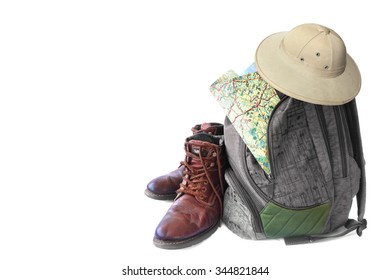 Old hiking boots, backpack with the map and hat (pith helmet,safari helmet) isolated on a white background