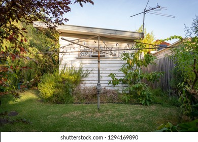 An old Hills Hoist clothes line in a Victorian back yard at sundown