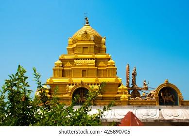 An old Hindu temple with architectural Golden detail. Murudeshwar. Karnataka, India