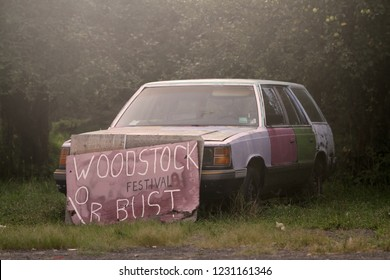 Old Hippy Woodstock Sign and Broke-Down Car