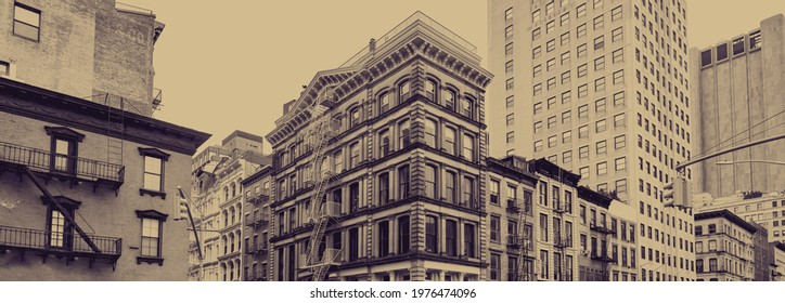 Old historic buildings in Tribeca, New York City with faded color effect